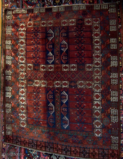 Ersari engi.  Good age.  Complete all around with original selvedge on sides and flatweave at top and bottom.  Generally low even pile with areas of full pile and exposed  ...