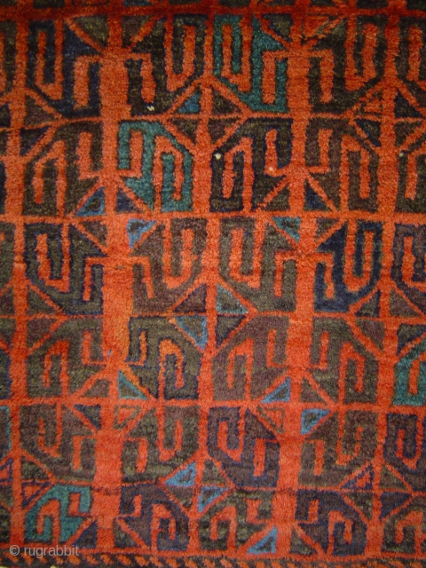 Detail of small antique Khorassan Baluch main carpet in excellent condition. Rare, reciprocal rendition ofarchaic gul repeat.