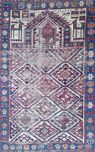 Unusual Shirvan prayer rug, Ivory Field with 10 hooked diamond guls in a hexagon lattice, 108 x 140 cm. Heavy wear as shown, one small hole, no repairs or restorations, original sides,  ...