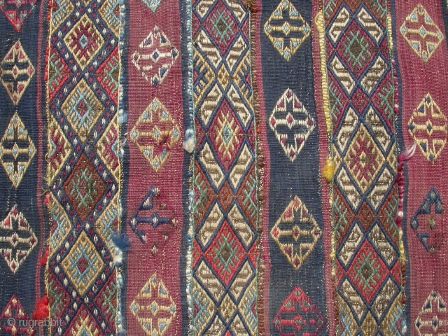 A cicim (brocade) runner, possibly Malatya area, mid to late 19th c. Poor condition with holes and scorch marks, but the item is complete with original borders and edge trim. It remains  ...