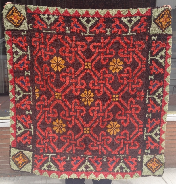 This looks like a bed covering that's been reduced to fit on a table. It's hand done and it has a very interesting weaving structure. It doesn't look like anything from Middle-east,  ...