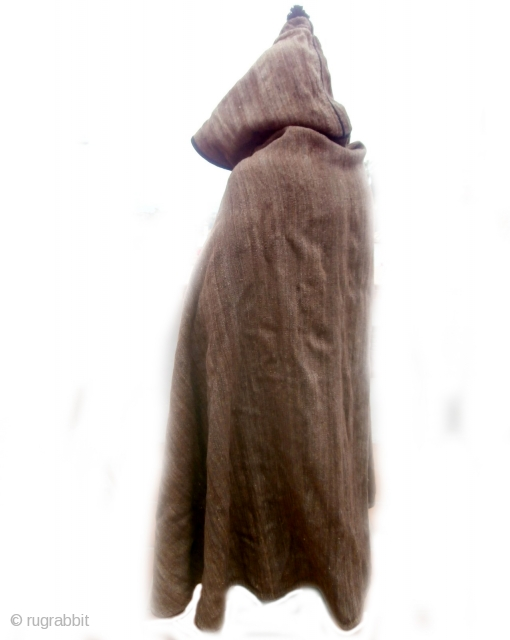 """MOROCCAN BERBER MAN'S CAPE WITH HOOD Many types of cape, or jellaha, are worn by men throughout Morocco. This is an example known as """"al bornoz"""" and is used by shepherds to  ..."""