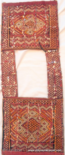 MOROCCAN BERBER MIDDLE ATLAS SADDLE BAG which is of exceptional fineness and was probably woven as a dowry piece. It has a plain, fine kilim background upon which design has been embroidered  ...