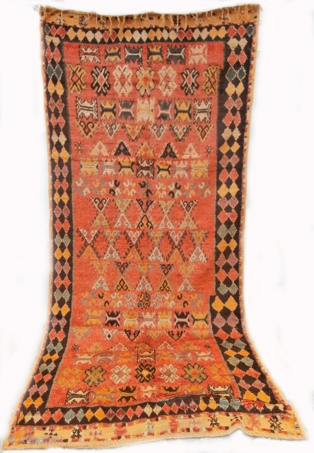 MOROCCAN BERBER HIGH ATLAS RUG with an exceptionally pleasing palette of colours and interesting design. It is an old rug dating from the mid 20th century and is from the region of  ...
