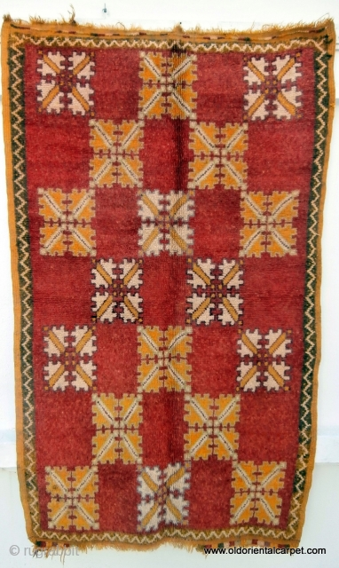 MOROCCAN BERBER HIGH ATLAS RUG. The region known as Djebel Siroua lies between the High and Anti Atlas mountains and it is from here that this old rug originates. There is a  ...