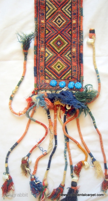 PERSIAN KURDISH ARTIFACT. This finely worked piece is a collar for a small animal and would be used on ceremonial occasions. The fine decorative tassles are intact and the piece is Kurdish  ...