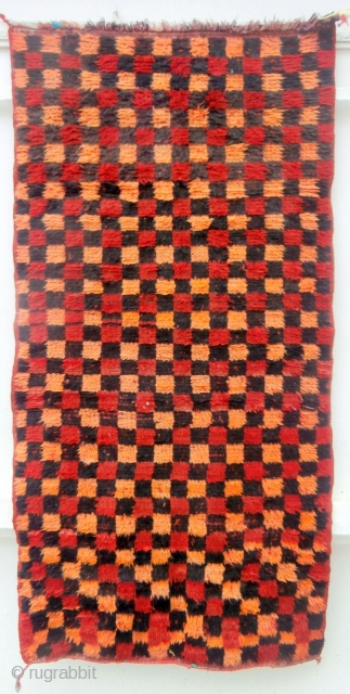 MOROCCAN MIDDLE ATLAS BERBER RUG originating from the Berbers of the region of Boujad where it was woven around 40/50 years ago. It is a piece which was used by a Berber  ...