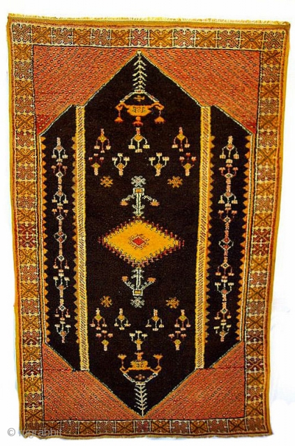 MOROCCAN HIGH ATLAS RUG A lustrous and old piece from the region of Tasenacht which lies south of Marrakech. It is in excellent condition, Reference 1549. Size 210 x 128cms.