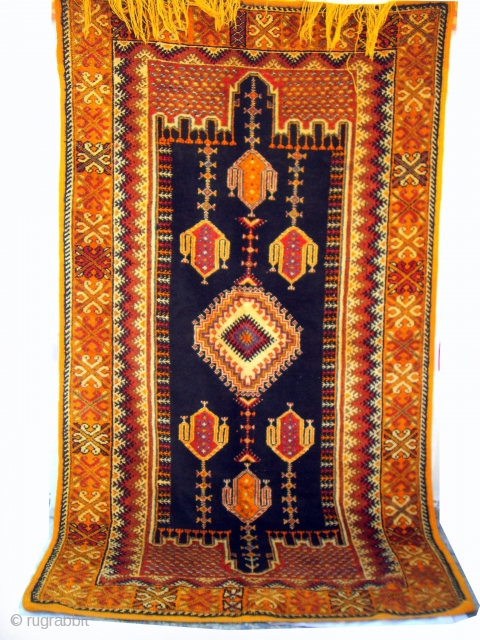MOROCCAN HIGH ATLAS BERBER RUG from the region of Ouaouzguite, south of Marrakech. This piece has incredibly lustrous hand spun wools and a beautiful depth of rich colours, together with an intricate  ...