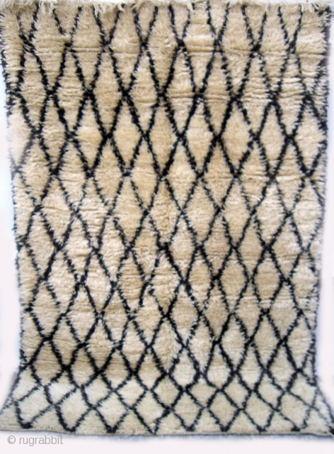 MOROCCAN BERBER BENI OURAIN RUG in which the warps, wefts and sumptuous long, silky knotted pile are all of hand spun undyed Berber wools. The simple lattice design is very pleasing. The  ...
