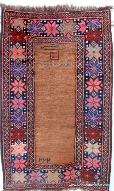 """RARE AFGHAN PRAYER RUG. The contents of the field make this an extraordinary and rare piece. At the top there are depictions of two pendants known as """"tumar"""". These are sometimes attached  ..."""