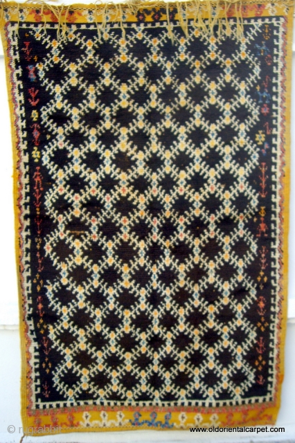 MOROCCAN HIGH ATLAS BERBER RUG. An old, rare and impeccable example from the region south of Tazenacht in the High Atlas. The wools are rich in lanolin and the knotting is extremely  ...