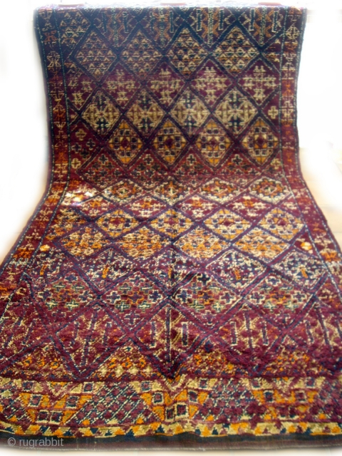 MOROCCAN BERBER MIDDLE ATLAS CARPET from the little known Ait Ben Aissa group in the Middle Atlas east of Fez. It has a rich and lustous pile with deep colour combinations and  ...