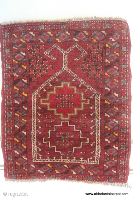 ERSARI TURKOMAN PRAYER RUG from the Beshir sub-tribe which originates from northern Afghanistan in the early 20th century. It has a wonderful pallette of natural colours with several shades of madder, undyed  ...