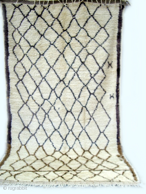 MOROCCAN HIGH ATLAS BERBER CARPET. In the foothills of the High Atlas lies the region of Azilal where this rug was woven. It has a simplistic portrayal of the Berber lattice design  ...