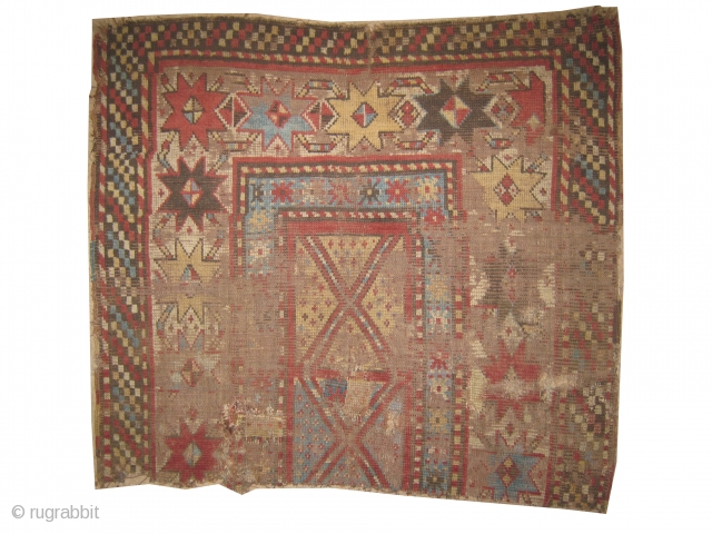 """Fragment Gendja Caucasian, knotted circa in 1840 antique, collector's item, Size: 112 x 100 (cm) 3' 8"""" x 3' 3""""  carpet ID: SA-1208 Rare example, in poor condition."""