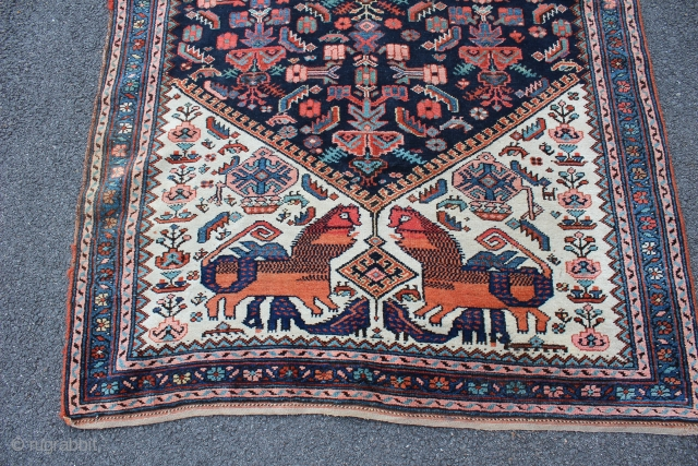 Kurdish Dragon battling Lion rug, ca 1920. Rare imagery of a Dragon biting a Lion on the back of the neck. Wool on wool. Colors appear natural. One very small corner repair  ...