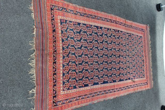 "Afshar Neriz Main Rug 4'9"" x 9'6"". Third to fourth quarter Nineteenth Century. There is a sewn tear on one kilim end. There is one fold wear. There is one old stain.  ..."