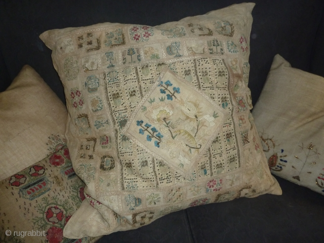 Better than average is the quality of the embroidery fragments of which this cushion was probably made in the european part of the ottoman empire 85 cm square, 34 inch