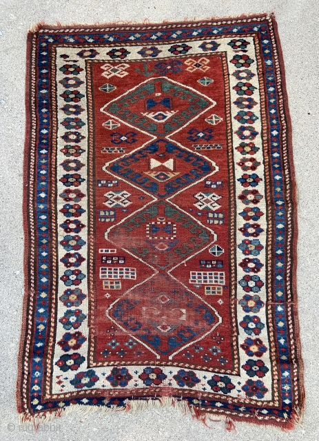 Small Caucasian Kazak Rug, highlights of deep purple, worn and frayed towards the bottom but otherwise thick pile - see details - 3'3 x 4'11 - 100 x 150 cm.