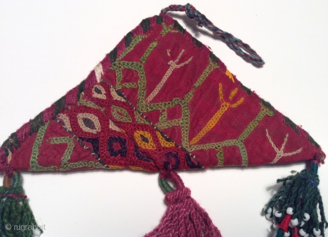 In the Central Asian Republics, people have made amulets in the shape of a triangle using felt, cloth or silver