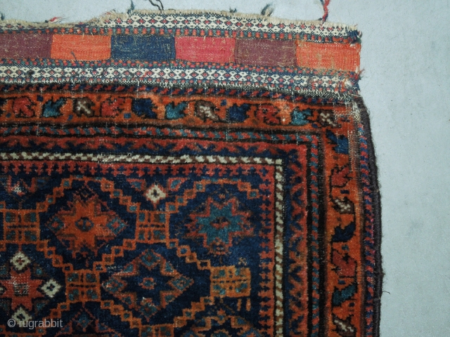 A 3rd. to 4th. Quarter 19th. Century Belouch bag with original back. Soft silky wool in jewel tone colors of navy blue, teal blue, two  shades of rust orange and a  ...