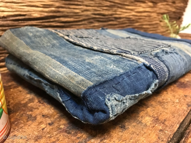 Highly desirable fabrics such as this one have become rare due to an ever larger demand in recent years. Made from various patches all in indigo blue, this piece is striking because  ...