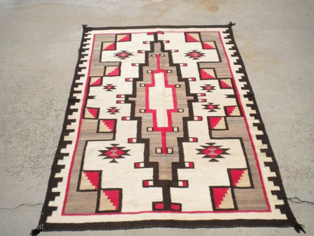 """Rug Curator's find as found: A 1940's to 1950's (perhaps older) Navajo rug measuring 48""""x 70"""" in very good condition.  Thanks for looking."""