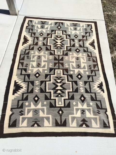 "The Rug Pickers find as found: A vintage regional Navajo measuring 4'10""x 7'3"", which is lovely in every way except for two or three tiny less than dime size spots that won't  ..."