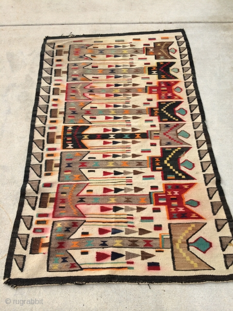 """Rug Pickers find as found:  A 1920's Navajo rug measuring 5'10""""x 3'8"""" that I can't pinpoint to a certain grouping or classification.  I want to say Yei, but that's probably  ..."""