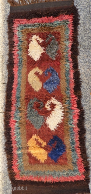 A great julkhir woven by Uzbek weavers in Afghanistan. The central field is occupied by enormous botehs. 258x103 cms. 1950S, (A1802027).
