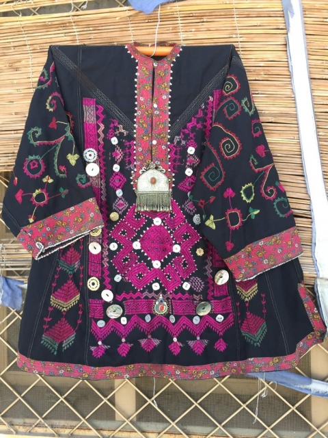 Tribal silk thread hand embroidered woman dresss from Kohistan region of northern Pakistan.In its best condition.
