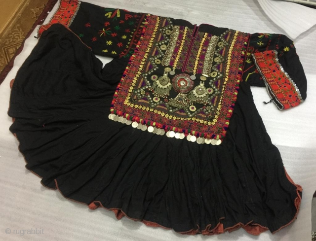 Tribal wedding dress of the bride called Jumlo from Kohistan  region of Pakistan.The dress is vintage.The embroidery is exquisite and pure hand embroidery. in its best condition  Length of the dress  40 inches  ...
