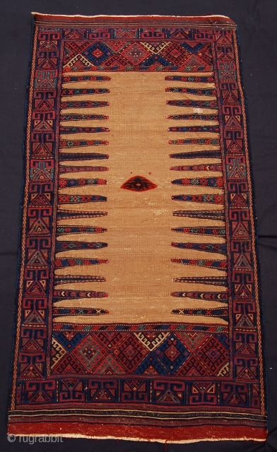 Super Kordi sofreh rug. Eastern Persia. 19th century. 148 x 77 cm. Camel hair ground with pile centre and flatweave borders.
