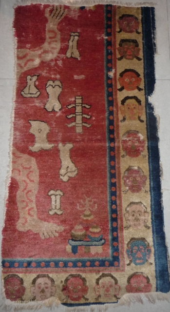 fragment of a very rare tantric rug depicting the tibetan sky burial. baotou/zuoqi area for the tibetan market.