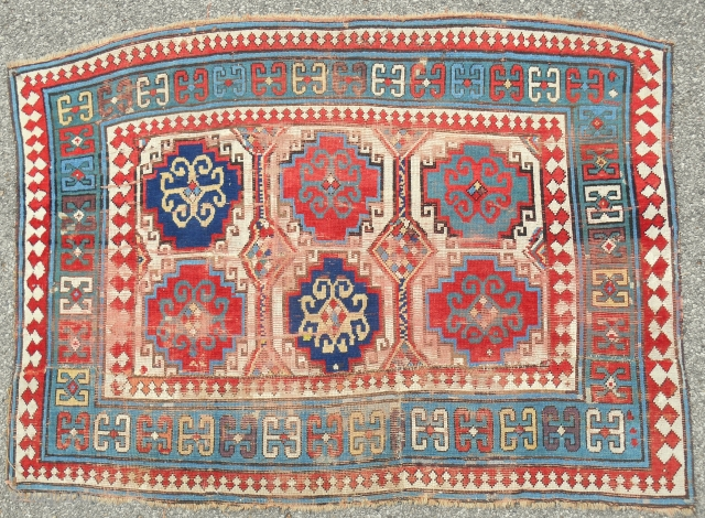 Reduced Caucasian Kazak rug fragment with some interesting features. Works well in this format. About 4 x 6 ft.  Good drawing, color and age. c. 1870.