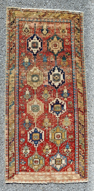 """Circa 1800,  small """"linked palmette"""" classical Caucasian rug with some old faded repair."""
