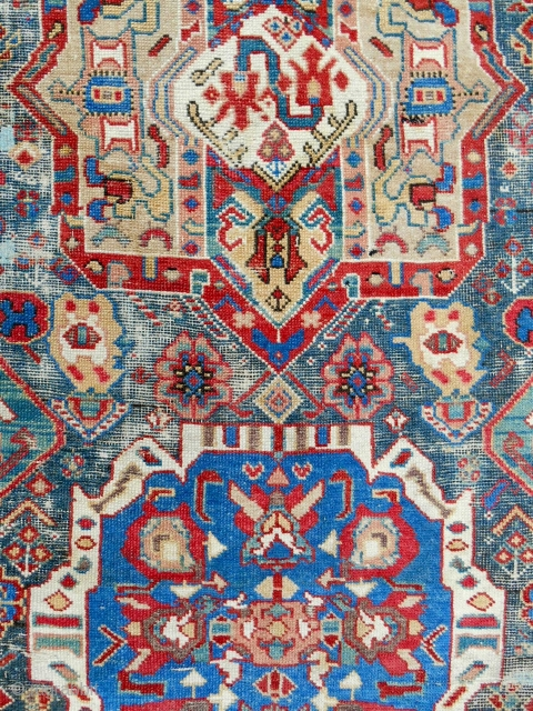 Rare Northwest Persian Kurdish rug. 3.5 x 7ft. Complete and original. Early 19th c. Corroded blue green field. Excellent, mellow, old colors including a good aubergine. Clean.
