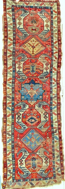 Extraordinary and whimsical Shahsavan long rug from the Moghan plain. Marvelous color. Reasonable condition. Mid 19th c. or older.