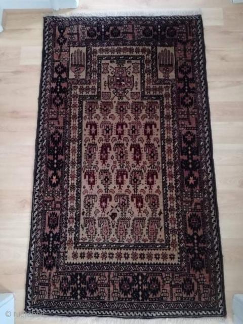 An old Baluch prayer rug in very good shape. 130/80 cm.