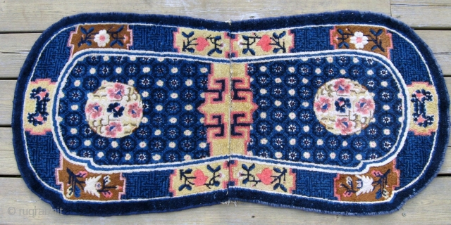 Antique Chinese saddle cover, 4' x 2', excellent condition with soft shiny wool, and well balanced design.  Blue is not as intense, over-saturated, as it appears in the picture.