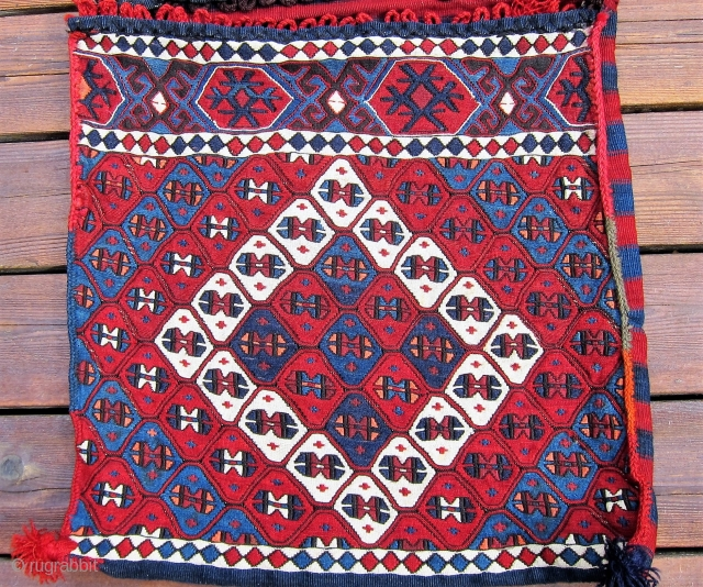 """Kagizman Kurdish Saddle Bags,  Late 19th C.,Size: 1'10"""" x 3'8"""",A rare, pristine complete pair of saddle bags woven in the weftless sumak technique. These bags with natural dyes were clearly woven  ..."""