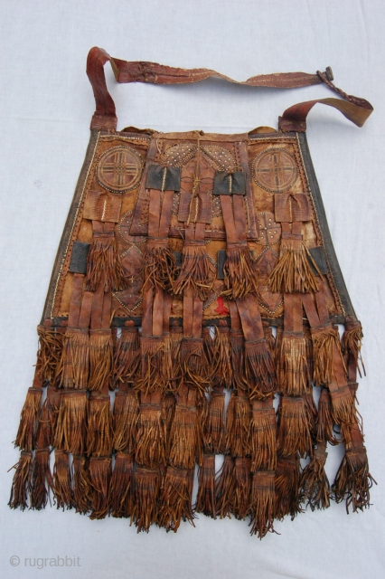 """Antique tribal Malinese Touareq conical shaped leather bag. 46/33 x 30 cm (1ft 6""""/1ft 1"""" x 1ft). Condition: good, original sides and back complete and intact, original leather tassels complete and intact,  ..."""