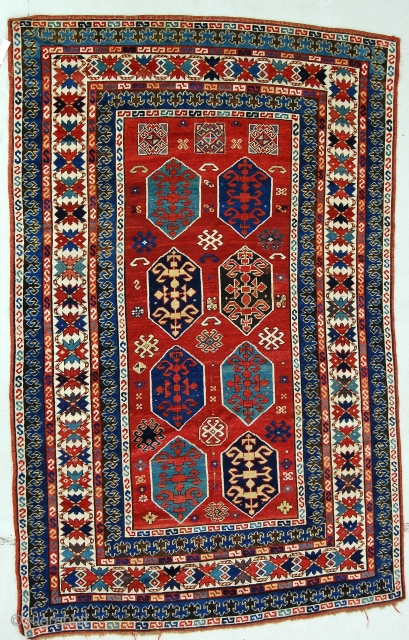 "5'2"" x 8' Kazak. Good color, decent condition. Areas of thiner pile, a few small fold wear lines and some losses in the brown the worst of which is visible in the  ..."