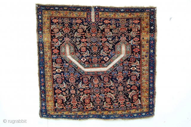 "3' x 3'7"" West Persian saddle rug. The design is Shene, but the back is a sort of Arak village weave. Good color, decent condition, all natural dyes."
