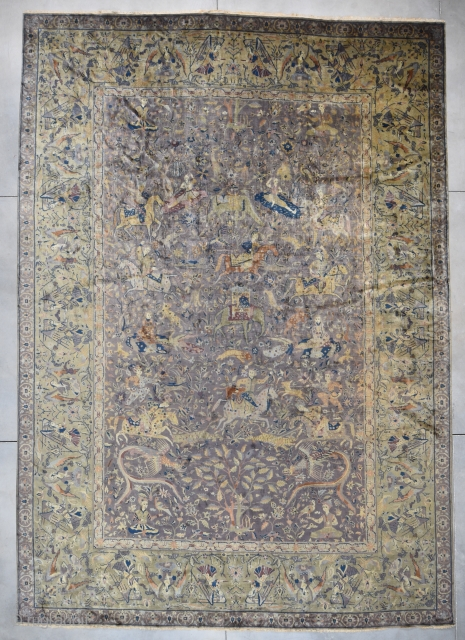 "This 1st half 20th century Amritsar Carpet from India measures 14'4"" X 20'3"". This rug is unbelievable. It has an absolutely gigantic hunting scene. The aubergine field is covered in men on  ..."