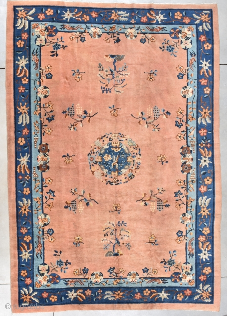"""Antique Peking Chinese Oriental Rug  #7924 This circa 1900 Peking Chinese rug measures 7'11"""" X 11'5"""". It has a beautiful peach colored field with a circular floral medallion with two parrots facing  ..."""