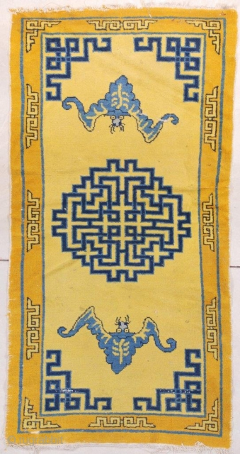 """This circa 1890 Chinese rug #7663 measures 3'1"""" x 5'11"""" (94 x 181 cm). There are two blue bats on a saffron yellow ground with Chinese fretwork in two shades of blue  ..."""