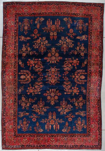 #7448 Kashan  This  Kashan measures 8 foot 11 inch by 13 foot 0 inches. It has a medium blue ground with an empty floral design scattered throughout the field in various shades  ...