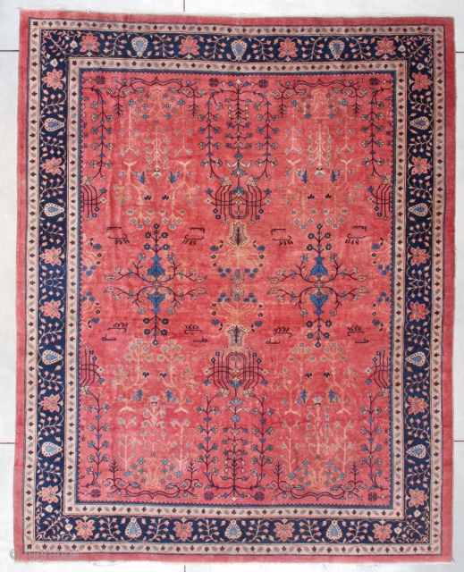 """#7469 Laristan  This dated 1916 Laristan Oriental Rug measures 9'0"""" X 11'2"""". It has a pale rose ground with an overall very open floral design in ivory and several shades of blue. The  ..."""